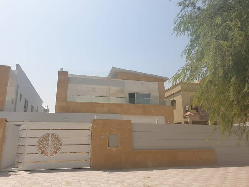 Villa for rent, personal finishing, excellent price, Ajman, close to the main street, a large building area. . .