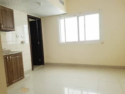 close to lulu hypermarket . . . 400 sq-ft studio rent 10k in 4 to 10 cheqs payment