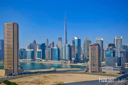 شقة 1 غرفة نوم للايجار في الخليج التجاري، دبي - Great Burj views | Modern finishes | Large balcony