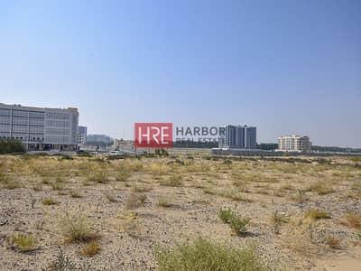 ارض سكنية  للبيع في دبي لاند، دبي - Investor's Deal |Prime Location Land | G+16 Allow