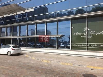 محل تجاري  للايجار في موتور سيتي، دبي - Only AED 120/- sqft | High Rise Office Tower