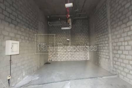 Shop for Rent in Arjan, Dubai - Small Shell & Core Retail with Good Height