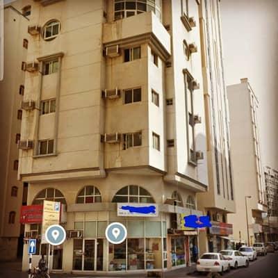 مبنى سكني  للبيع في الغرب، الشارقة - للبيع بناية بالشارقة