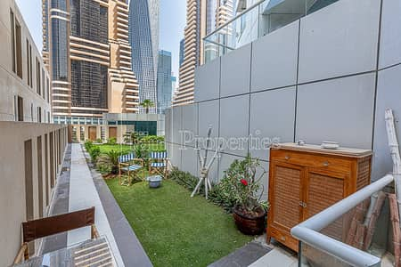 1 Bedroom Apartment for Rent in Dubai Marina, Dubai - Tastefully Furnished 1BR Duplex with Backyard