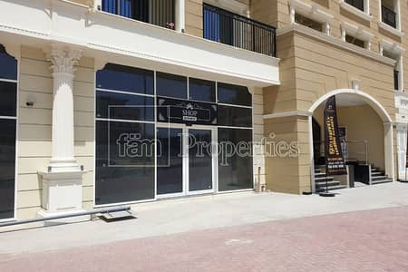 Shop for Sale in Arjan, Dubai - Located on the main road | High Ceiling