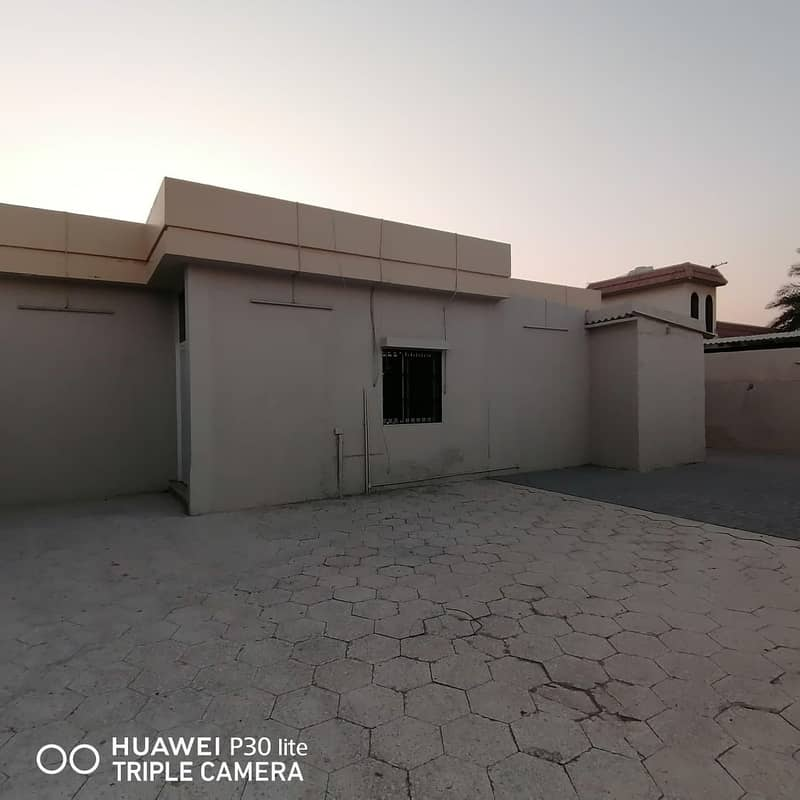 A BIG 4 BHK VILLA WITH GARDEN PLUS COVERED PARKING IS AVAIL ABLE IN 58K IN AL KHEZAMIA SHARJAH