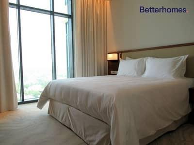 فلیٹ 1 غرفة نوم للبيع في التلال، دبي - High Floor | Serviced Apartment| Lake view