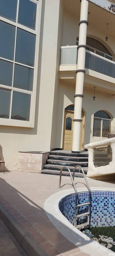 Doube story 4 bedroom hall villa for rent in Al Rifah + Swimming pool