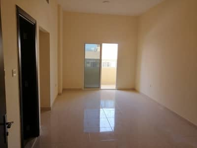 2 Bedroom Apartment for Rent in Al Rawda, Ajman - For lovers of luxury and large spaces, a two-room apartment and a hall with a balcony on Sheikh Ammar Street in Rawda