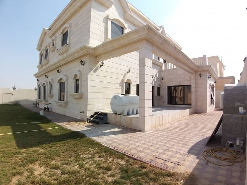 Brand New 2 floor luxury 5BR Villa with covered swimming pool and garden in Hoshi, Sharjah