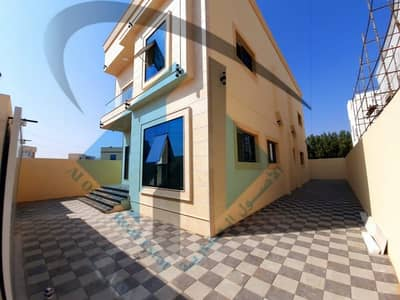 Villa for sale in the emirate of Ajman, Al Yasmeen area, excellent new finishing, first inhabitant Central air-conditioning Stone facade