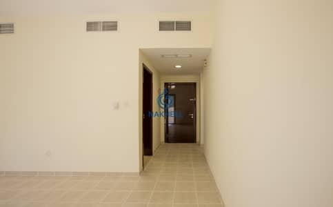 شقة 1 غرفة نوم للايجار في الحدائق، دبي - High Floor 1 BR - Save 1 Month Rent