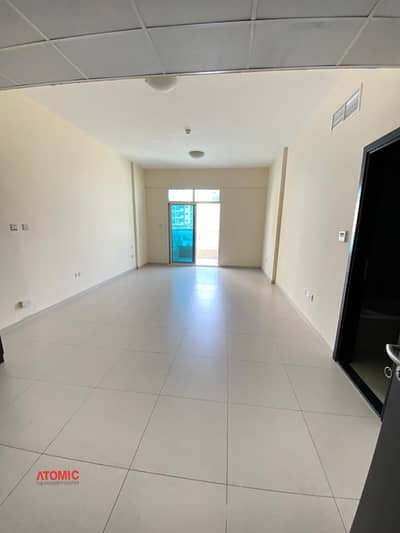 Studio for Rent in International City, Dubai - Hot offer one month free large studio with balcony for rent in Warsan4-01