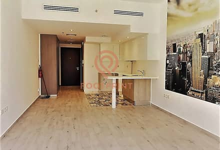 Studio for Rent in Jumeirah Village Circle (JVC), Dubai - Luxury Finishing | Spacious Studio with Balcony | Wooden Flooring
