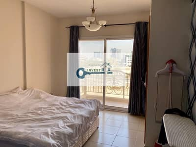 Studio for Rent in Jumeirah Village Circle (JVC), Dubai - Huge L  Shape Unfurnished Studio Well Maintained In an Amazing Deal