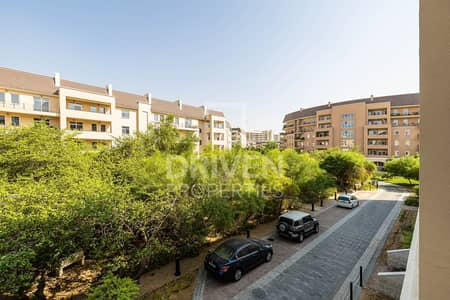 1 Bedroom Apartment for Sale in Motor City, Dubai - Courtyard and Garden View | Private Balcony