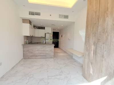 استوديو  للايجار في قرية جميرا الدائرية، دبي - Most Affordable Studio Apt. with Balcony | Kitchen Appliances | Joya Verde Resi.