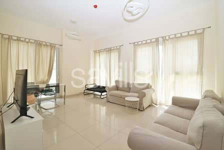 2 Bedroom Apartment for Sale in Muwaileh, Sharjah - Corner furnished unit with garden on pool