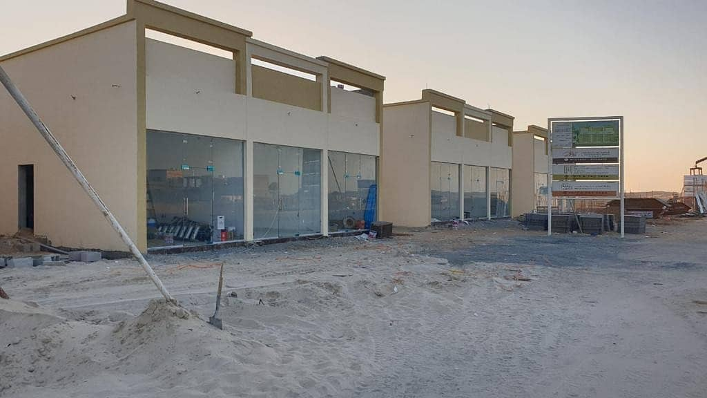 For sale a commercial building on a paved street in Al Zahia Ajman and near Sheikh Mohammed Bin Zayed Street. . .