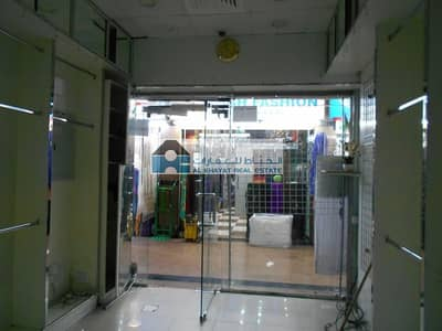 محل تجاري  للايجار في ديرة، دبي - Retail Shop in high foot traffic area of Al Sabkha Bus Station