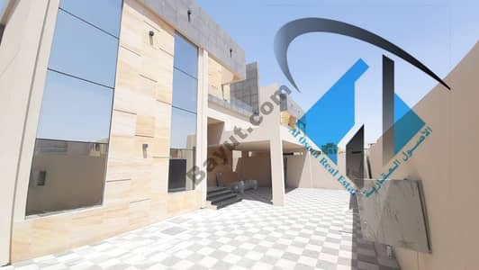 For sale villa in Ajman on a residential, commercial, European street, with monthly installments for a period of 25 years, with a large bank leniency