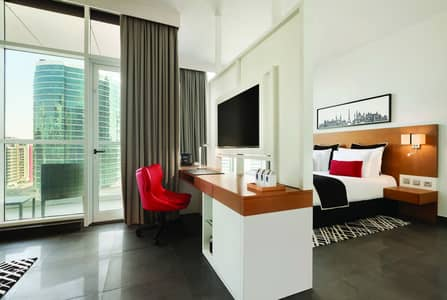 Hotel Apartment for Rent in Dubai Internet City, Dubai - Bedroom and lounge