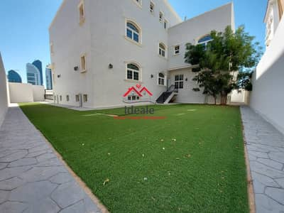 11 Bedroom Villa for Rent in Al Bateen, Abu Dhabi - Grand living spaces with an air of elegance | lift and garden