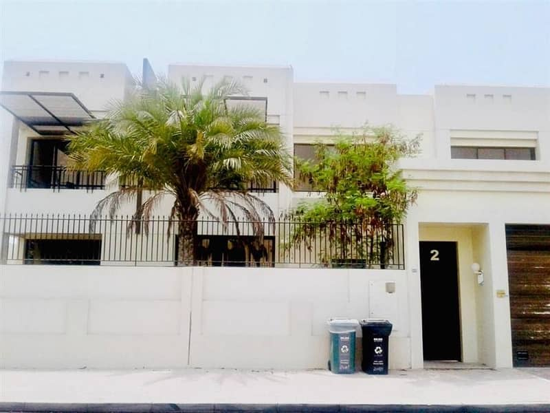 New finish modern 5 bedroom plus maid compound villa with shared pool in Jumeirah 3