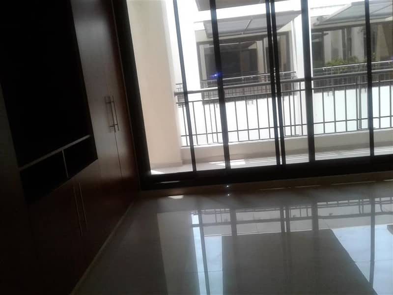 13 New finish modern 5 bedroom plus maid compound villa with shared pool in Jumeirah 3