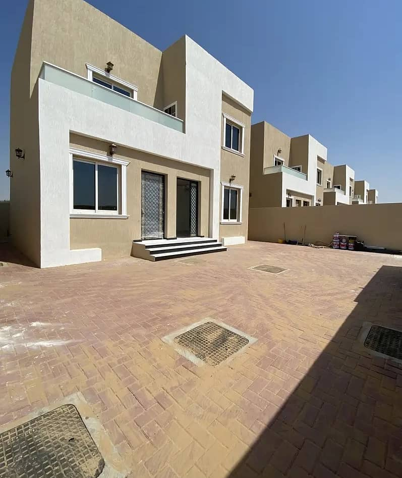 For sale without down payment and very affordable monthly installment, a new villa, the first inhabitant, with finishing and an excellent price, in the Al Zahia area on the asphalt street near Sheikh Mohammed Bin Zayed Road