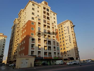 Shop for Sale in International City, Dubai - Prime location in Central Business District | Fitted