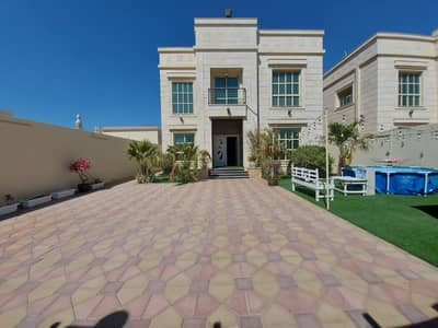For sale a villa in Ajman connected to electricity and water, with a stone face for the entire villa, a very excellent location without down payment and on monthly installments for a period of 25 years with a large bank leniency