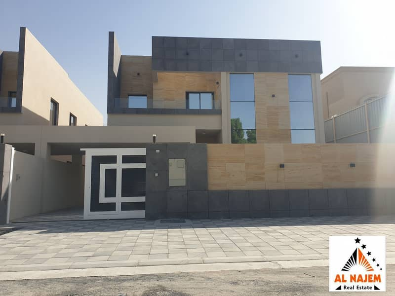 Sale: A new villa with a luxurious modern design in Al Rawda 1 area close to the main street, with the possibility of bank or cash financing