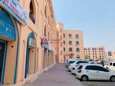 Shop for Rent in International City, Dubai - Backside Corner Shop/International city/Good Location
