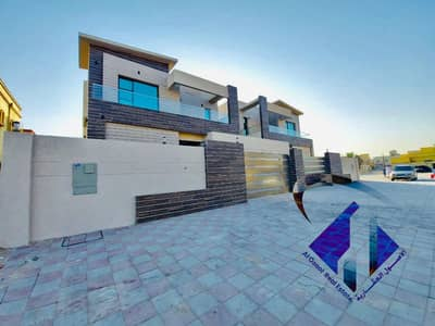 5 Bedroom Villa for Sale in Al Rawda, Ajman - For sale, a villa in Ajman, a second piece of Sheikh Ammar Street, very excellent finishing without a down payment and on monthly installments for a period of 25 years with a large bank credit