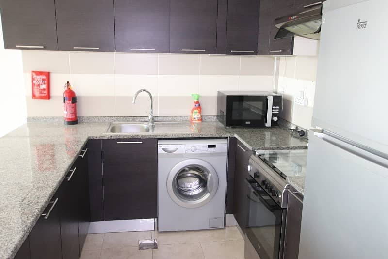 2 Fully Equipped Kitchen  Pool View   Middle Unit  1BR+Blcny