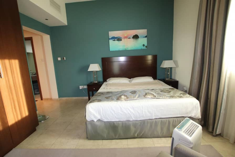 Fully Equipped Kitchen  Pool View   Middle Unit  1BR+Blcny
