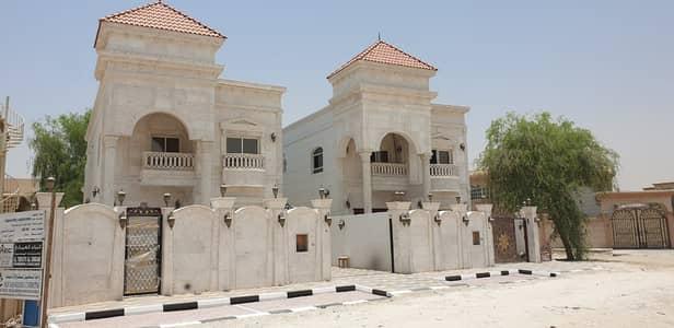 فیلا 5 غرف نوم للبيع في المويهات، عجمان - فيلا تشطيب راقي  قريبه الشارع الاسفلت واجهة حجر