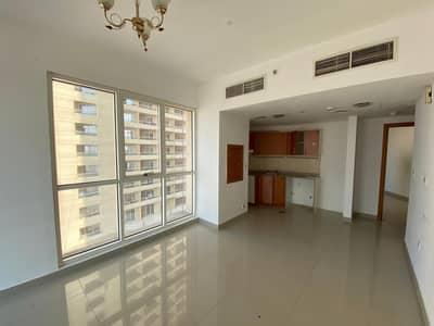 شقة 1 غرفة نوم للايجار في مدينة دبي للإنتاج، دبي - Bright and Spacious One Bedroom Apartment in Production City