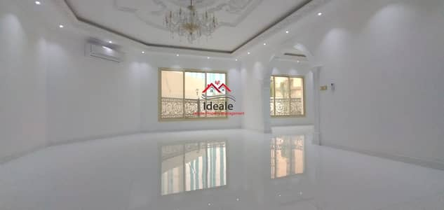 Building for Rent in Al Karamah, Abu Dhabi - First tenant villa with balcony and garden