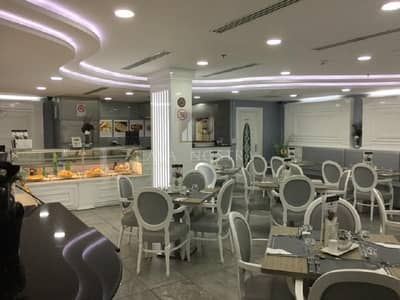 Shop for Sale in Jumeirah Lake Towers (JLT), Dubai - Luxury White Ambient Restaurant Negotiable