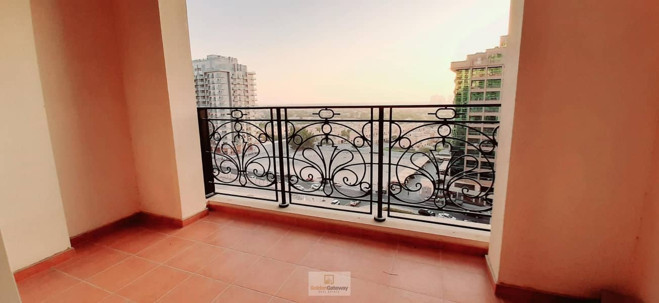 12 Closed Kitchen+Laundry-2 Balcony Partial Golf View