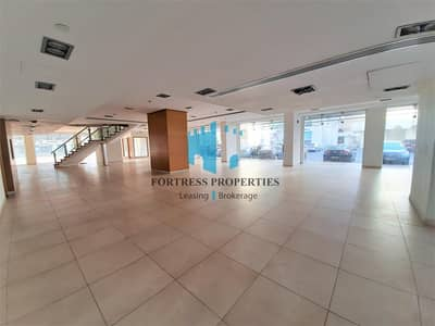Showroom for Rent in Electra Street, Abu Dhabi - Corner SHOWROOM in the Heart of Electra Street   GF + M & Basement    1