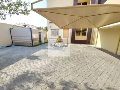 5 Bedroom Villa for Rent in Shakhbout City (Khalifa City B), Abu Dhabi - Private Entrance | Covered Garage | Balconies