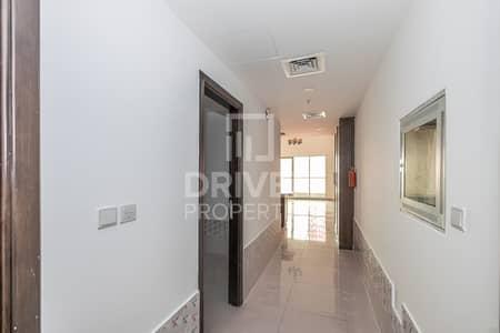 Studio for Rent in Dubai Sports City, Dubai - Storage Room | Chiller Included | Studio