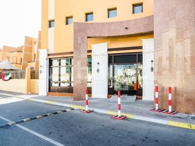 محل تجاري  للايجار في الكرامة، أبوظبي - محل تجاري في قرية ليوا الكرامة 500000 درهم - 4875516