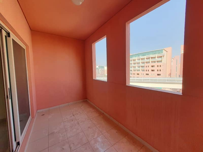 KILLER DEAL - CHILLER, MAINTENANCE & ONE MONTH FREE - STUDIO WITH BOXED, BIG BALCONY- FOR ONLY AED 22,800/-