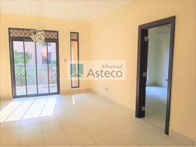 1 Bedroom Flat for Rent in Old Town, Dubai - Balcony facing Garden   Closed Kitchen   Low FLoor