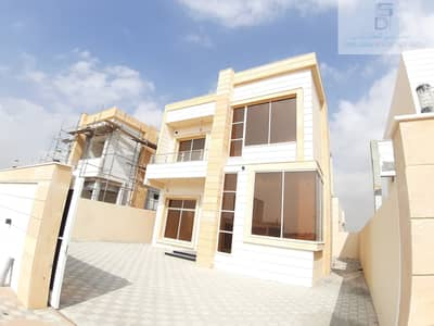 4 Bedroom Villa for Sale in Al Helio, Ajman - Villa with modern design and a stone frontage in Jasmine Very good interior finishing