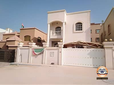 5 Bedroom Villa for Rent in Al Mowaihat, Ajman - Villa for rent citizen electricity with air conditioners, stone front, super deluxe finishing